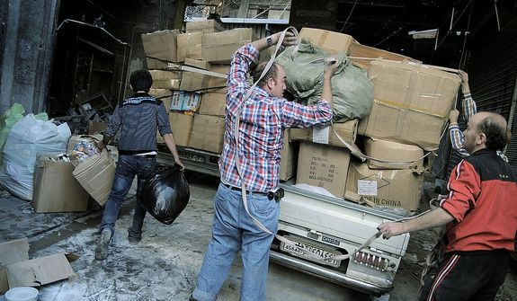 Merchants remove their wares Nov. 6, 2012, from the souk in the Old City of Aleppo, Syria. (Associated Press)