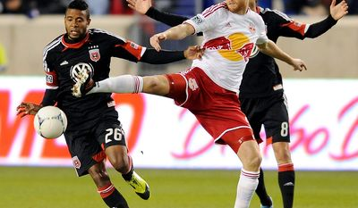 New York Red Bulls defender Markus Holgersson controls the ball in front of D.C. United forward Lionard Pajoy (26) and Branko Brskovic (8) during the first half of an MLS Eastern Conference semifinal playoff soccer game on Nov. 8, 2012, in Harrison, N.J. (Associated Press)