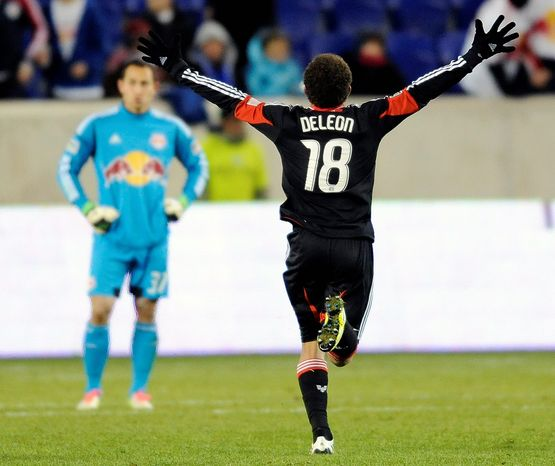 D.C. United midfielder Nick DeLeon celebrates at the end of the MLS Eastern Conference semifinal playoff soccer game as New York Red Bulls goalkeeper Luis Robles watches on Nov. 8, 2012, in Harrison, N.J. DeLeon scored the only goal of the game as D.C. United defeated the Red Bulls, 1-0, to advance to the next round. (Associated Press)