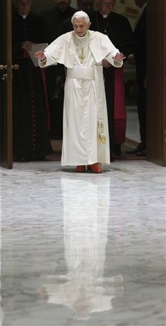 "Pope Benedict XVI waves upon his arrival for a meeting with the ""Santa Cecilia"" association, at the Vatican, Saturday, Nov. 10, 2012."