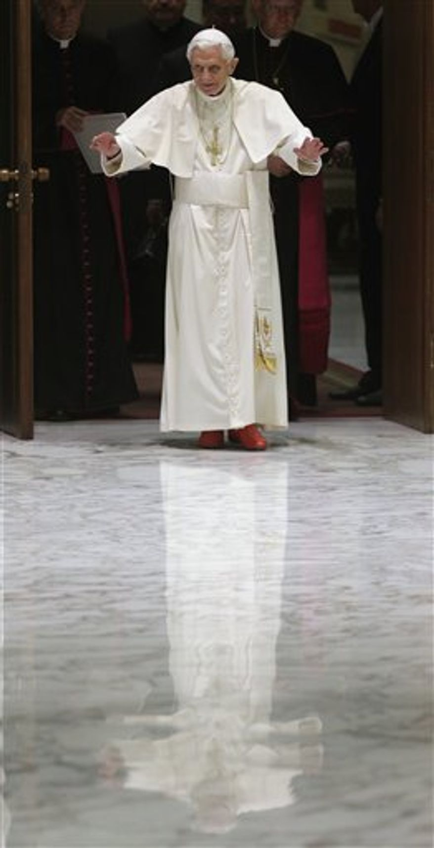 """Pope Benedict XVI waves upon his arrival for a meeting with the """"Santa Cecilia"""" association, at the Vatican, Saturday, Nov. 10, 2012."""