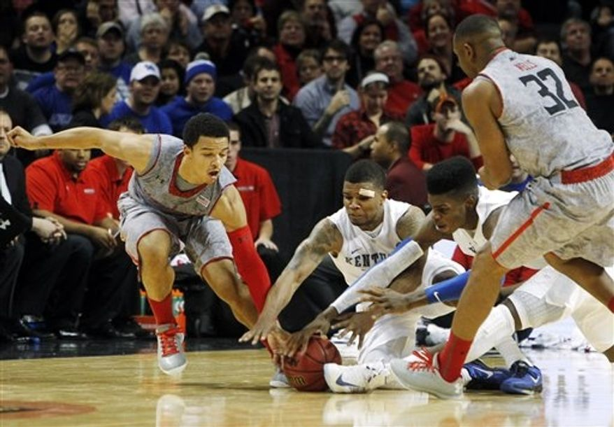 Kentucky's Julius Mays, second left, and Nerlens Noel, second from right, dive for a loose ball against Maryland's Seth Allen, left, and Dez Wells (32) during the second half of their NCAA college basketball game in the Barclays Center Classic, Friday, Nov. 9, 2012, in New York. Kentucky won 72-69. (AP Photo/Jason Decrow)