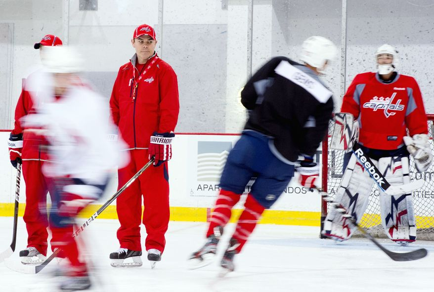 Capitals coach Adam Oates (second from left) was able to oversee prospects at development camp, then came the NHL lockout. (Andrew Harnik/The Washington Times)