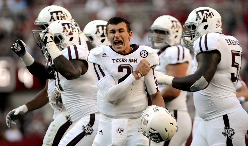 Texas A&M quarterback Johnny Manziel (2) celebrates after a review proves an Aggie touchdown during the first half of their first SEC meeting against and Alabama in an NCAA college football game, Saturday, Nov. 10, 2012, in Tuscaloosa, Ala. No. 15 Texas A&M defeated No. 1 Alabama 29-24. (AP Photo/The Decatur Daily, Gary Cosby Jr.)