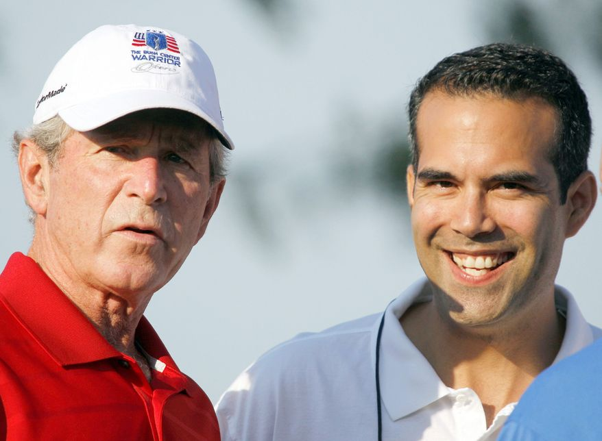 Former President Bush watches golf in Irving, Texas, with his nephew, George P. Bush, 26, who has made a campaign filing in Texas that is required of anyone planning to run for state office, though he did not have to specify what office. The son of former Florida Gov. Jeb Bush is a graduate of the University of Texas law school who now runs a real estate investment firm and a consulting firm in Texas. (Associated Press)