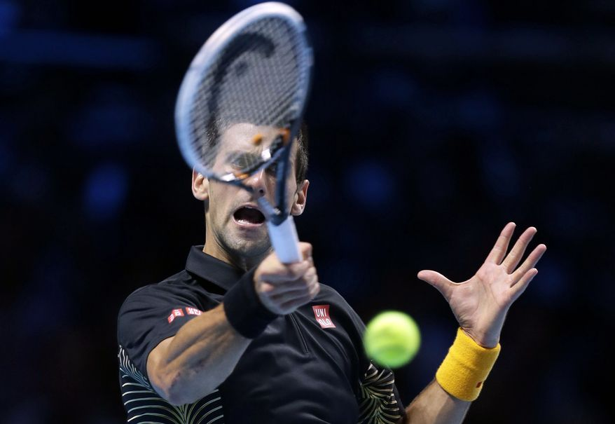 Novak Djokovic plays a return to Juan Martin Del Potro during their ATP World Tour Finals singles semifinal match on Nov. 11, 2012, at the O2 Arena in London. (Associated Press)