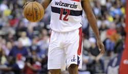 Washington Wizards point guard A.J. Price (12) dribbles the ball against the Boston Celtics during the second half of an NBA basketball game, Saturday, Nov. 3, 2012, in Washington. The Celtics won 89-86. (AP Photo/Nick Wass)