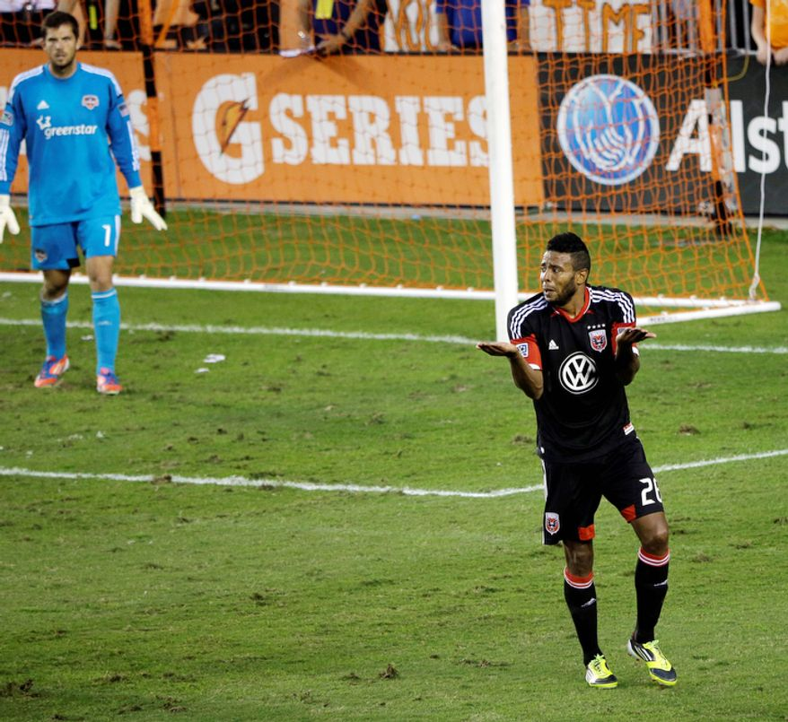 D.C. United's Lionard Pajoy, right, reacts after being called for a foul against the Houston Dynamo during the second half of an MLS Eastern Conference Championship soccer game, Sunday, Nov. 11, 2012, in Houston. The Dynamo won 3-1. (AP Photo/David J. Phillip)