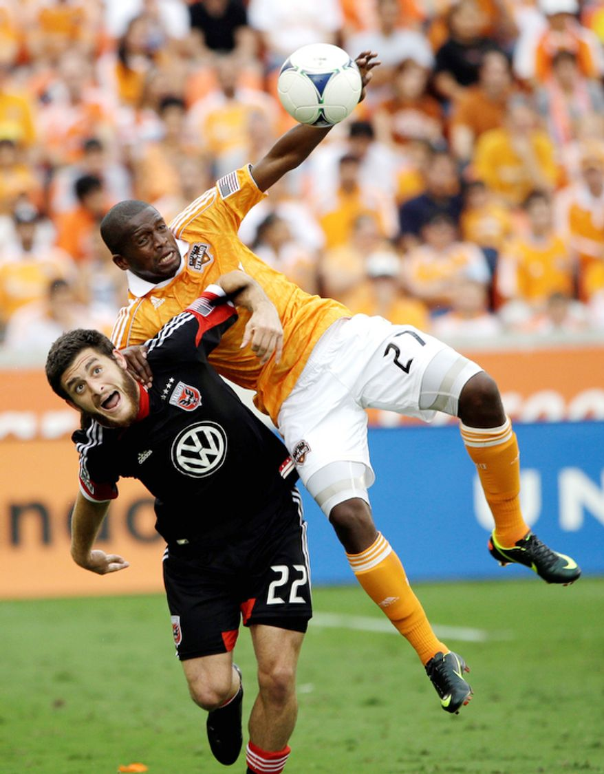 D.C. United's Chris Korb (22) battles Houston Dynamo's Boniek Garcia (27) for the ball during the first half of an MLS Eastern Conference Championship soccer game on Sunday, Nov. 11, 2012, in Houston. (AP Photo/David J. Phillip)