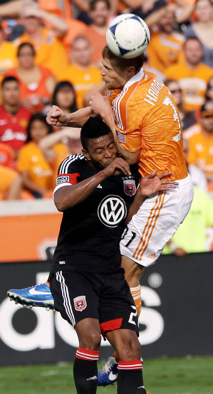 D.C. United's Lionard Pajoy, left, collides with Houston Dynamo's Andre Hainault (31) during the first half of an MLS Eastern Conference Championship soccer game, Sunday, Nov. 11, 2012, in Houston. (AP Photo/David J. Phillip)