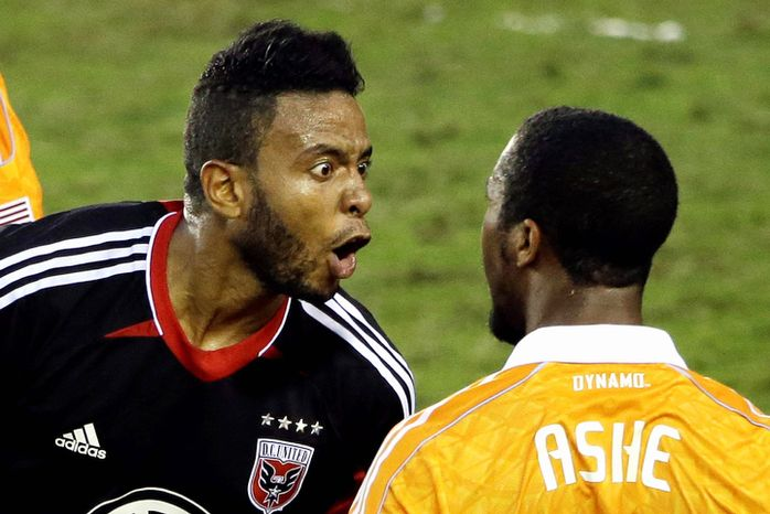 D.C. United's Lionard Pajoy, left, yells at Houston Dynamo's Corey Ashe after being called for a foul during the second half of an MLS Eastern Conference Championship soccer game, Sunday, Nov. 11, 2012, in Houston. The Dynamo defeated D.C. United 3-1. (AP Photo/David J. Phillip)
