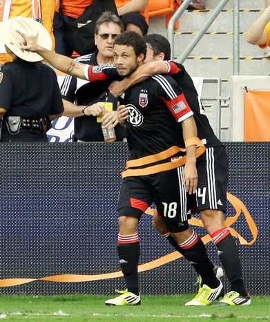 D.C. United's Nick DeLeon (18) celebrates his goal with Lewis Neal, right, during the first half of an MLS Eastern Conference Championship soccer game against the Houston Dynamo, Sunday, Nov. 11
