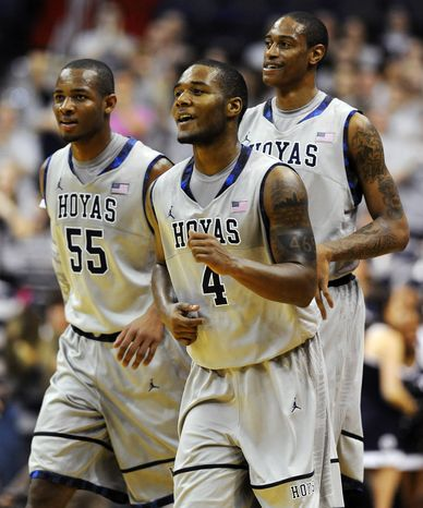 Georgetown guard D'Vauntes Smith-Rivers (4) leaves the court with Jabril Trawick (55) and Greg Whittington during their 61-55 win over Duquesne in their NCAA college basketball game, Sunday, Nov. 11, 2012, in Washington. (AP Photo/Richard Lipski)