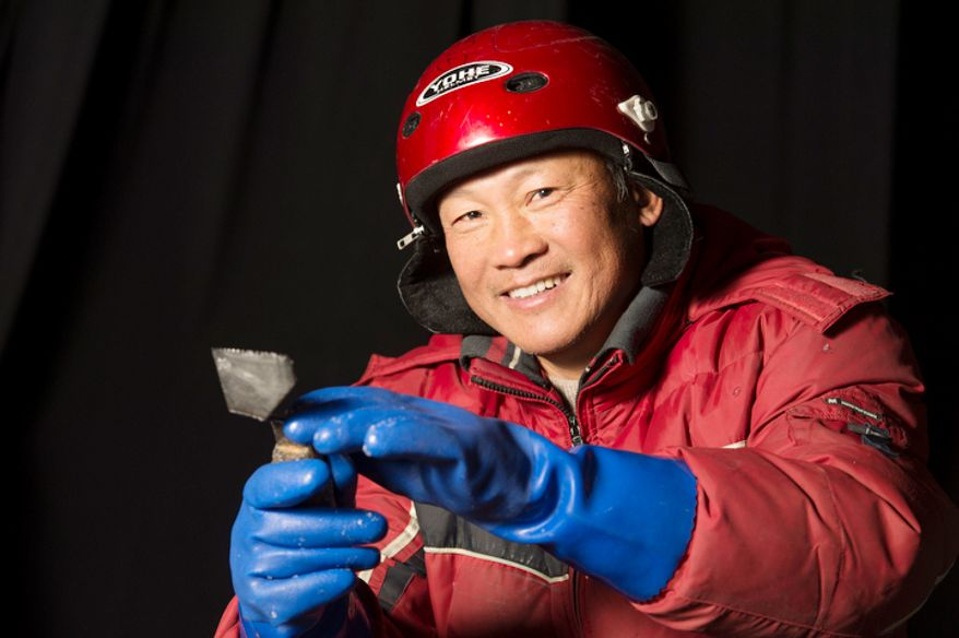 Guo Baiwei, 57, is one of the 40 artisan ice sculptors from Harbin, China,  working on the construction of the attraction ICE! featuring DreamWorks Shrek the Halls at the Gaylord National Resort & Convention Center in National Harbor, Md., Friday, Nov. 9, 2012. T (Rod Lamkey Jr./The Washington Times)