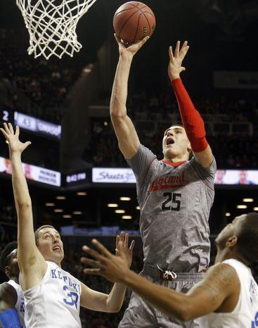 Maryland's Alex Len (25), of Ukraine, shoots over Kentucky's Kyle Wiltjer (33) during the first half of their NCAA college basketball game in the Barclays Center Classic, Friday, Nov. 9, 2012, in New York. (AP Photo/Jason Decrow)