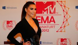 ** FILE ** Presenter Kim Kardashian arrives on the red carpet of the 2012 MTV European Music Awards show at the Festhalle in Frankfurt, central Germany, Sunday, Nov. 11, 2012. (AP Photo/Frank Augstein)