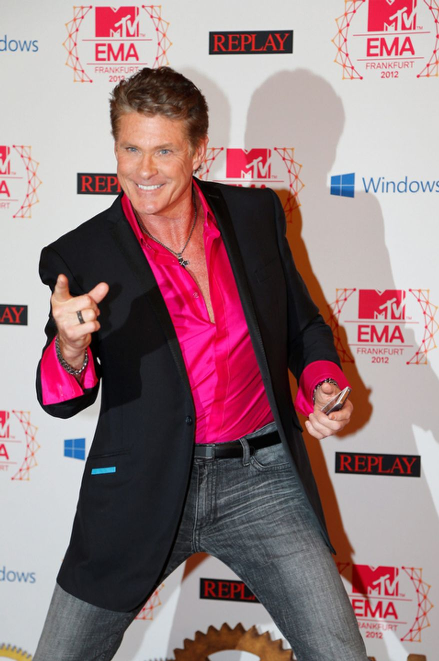US actor David Hasselhoff arrives on the red carpet of the 2012 MTV European Music Awards show at the Festhalle in Frankfurt, central Germany, Sunday, Nov. 11, 2012. (AP Photo/Frank Augstein)