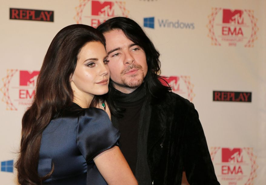 Lana Del Ray and Barrie-James O'Neill arrive on the red carpet of the 2012 MTV European Music Awards show at the Festhalle in Frankfurt, central Germany, Sunday, Nov. 11, 2012. (AP Photo/Frank Augstein)