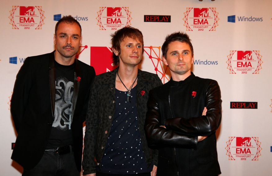 British band Muse arrive on the red carpet of the 2012 MTV European Music Awards show at the Festhalle in Frankfurt, central Germany, Sunday, Nov. 11, 2012. (AP Photo/Frank Augstein)