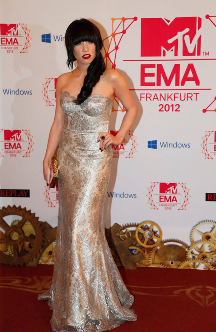 Canadian singer Carly Rae Jepsen arrives on the red carpet of the 2012 MTV European Music Awards show at the Festhalle in Frankfurt, central Germany, Sunday, Nov. 11, 2012. (AP Photo/Frank Augstein)