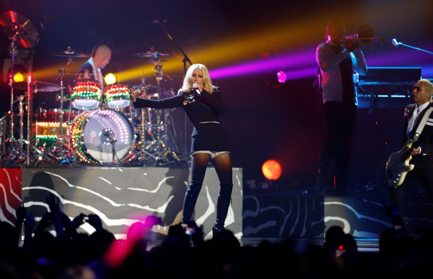 Gwen Stefani, center, performs with her band No Doubt during the 2012 MTV European Music Awards show at the Festhalle in Frankfurt, central Germany, Sunday, Nov. 11, 2012. (AP Photo/Michael Probst)