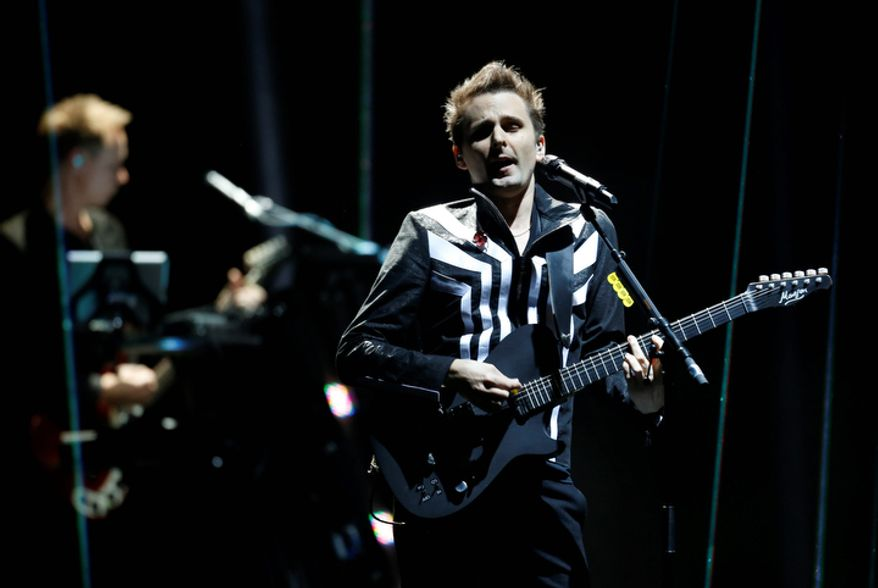 British band Muse perform during the 2012 MTV European Music Awards show at the Festhalle in Frankfurt, central Germany, Sunday, Nov. 11, 2012. (AP Photo/Michael Probst)