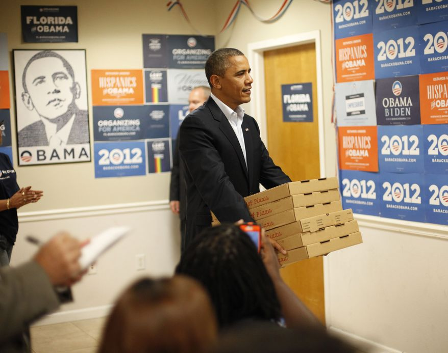 **FILE** President Obama delivers pizzas Oct. 28, 2012, to volunteers during an unscheduled visit to a local campaign field office in Orlando Fla. (Associated Press)