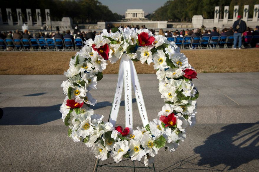 A wreath stands at the entrance of the National World War II Memorial in Washington, D.C., Sunday, Nov. 11, 2012. (Rod Lamkey Jr./The Washington Times)