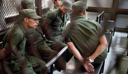 Detained Guatemalan Army soldiers wait to testify at a court hearing, in Guatemala City in October. Nine soldiers, including Army Col. Juan Chiroy Sal, were arrested and accused of extrajudicial killings at a Oct. 4 demonstration in Totonicapan, west of Guatemala City. (Associated Press)