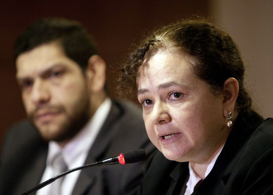 Guatemala Attorney General Claudia Paz y Paz is an aggressive prosecutor who gets support from the United States and other countries that provide aid to Guatemala. Arturo Aguilar is her secretary. (Associated Press)