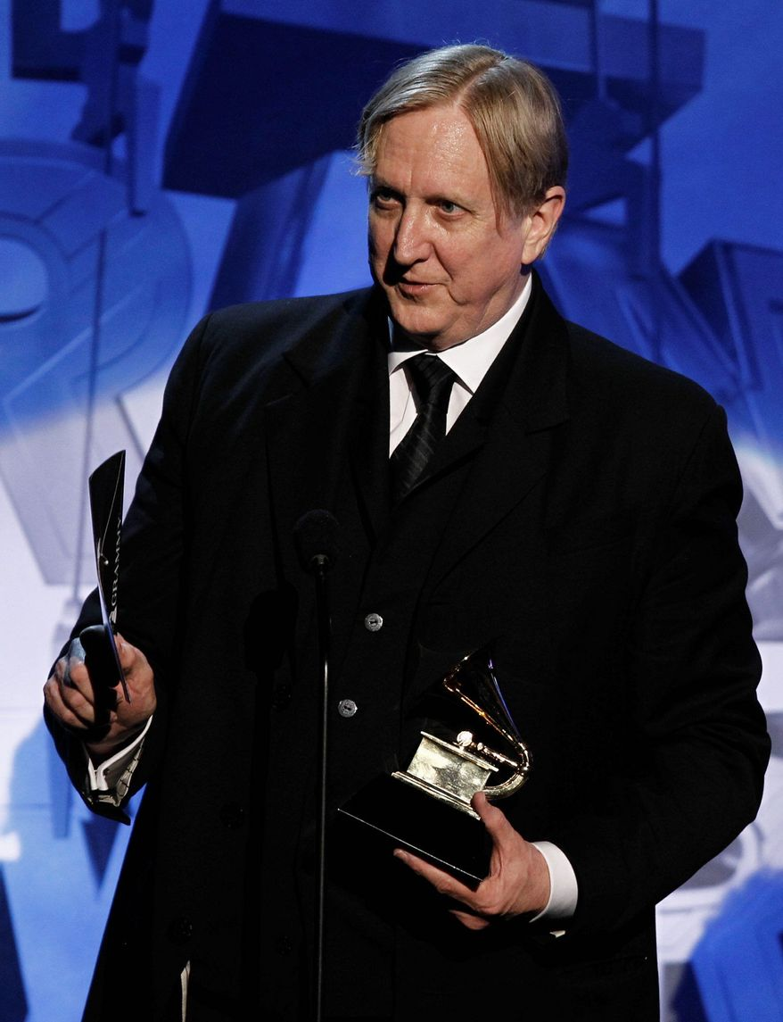 T-Bone Burnett accepts the award for best compilation soundtrack album during the pre-telecast at the 53rd annual Grammy Awards on Sunday, Feb. 13, 2011, in Los Angeles. (AP Photo/Matt Sayles)