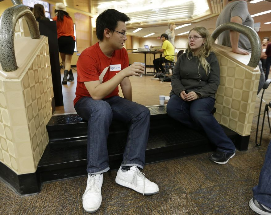 **FILE** Reyes Jiang of China talks Nov. 9, 2012, with Alexus Hall during Cultural Coffee Hour that was hosted by the Japanese Student Association on the campus of Indiana University in Bloomington, Ind. (Associated Press)