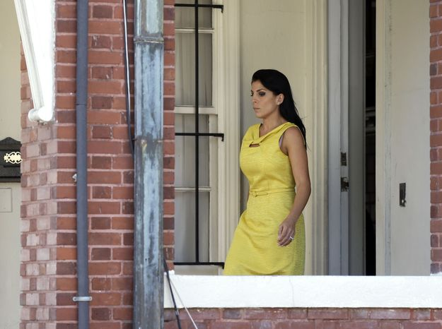 Jill Kelley leaves her home Monday, Nov. 12, 2012 in Tampa, Fla. Kelley is identified as the woman who allegedly received harassing emails from Gen. David Petraeus' paramour, Paula Broadwell. She serves as an unpaid social liaison to MacDill Air Force Base in Tampa, where the military's Central Command and Special Operations Command are located. (AP Photo/Chris O'Meara)