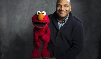 "**FILE** Puppeteer Kevin Clash poses Jan. 24, 2011, with ""Sesame Street"" muppet Elmo for a portrait in the Fender Music Lodge during the 2011 Sundance Film Festival to promote the film ""Being Elmo"" in Park City, Utah. (Associated Press)"