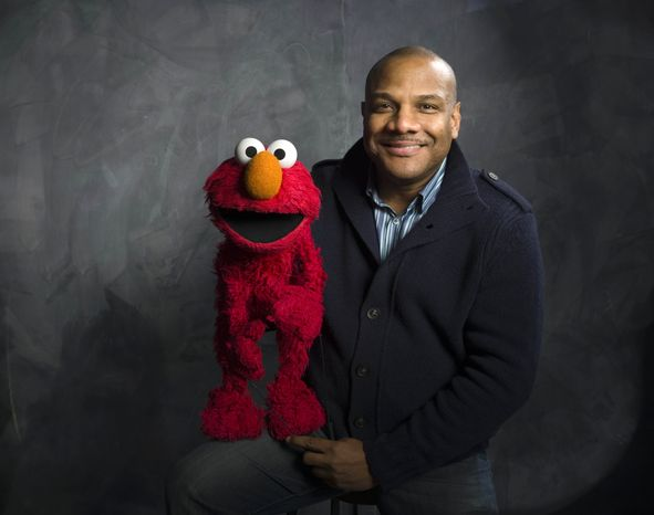"""**FILE** Puppeteer Kevin Clash poses Jan. 24, 2011, with """"Sesame Street"""" muppet Elmo for a portrait in the Fender Music Lodge during the 2011 Sundance Film Festival to promote the film """"Being Elmo"""" in Park City, Utah. (Associated Press)"""