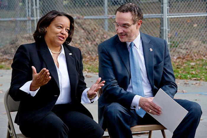 "Tomi Rucker, a Washington, D.C. Navy mom, talks with Mayor Vincent Gray at the D.C. World War I Memorial on Monday, Nov. 12, 2012 about the inconsistent flying of the D.C. flag at military graduations. Ms. Rucker says she was ""saddened"" when the D.C. flag was not a part of her son's boot camp graduation, particularly because the flags of the other recruits' states were part of the ceremony. (Barbara L. Salisbury/The Washington Times)"
