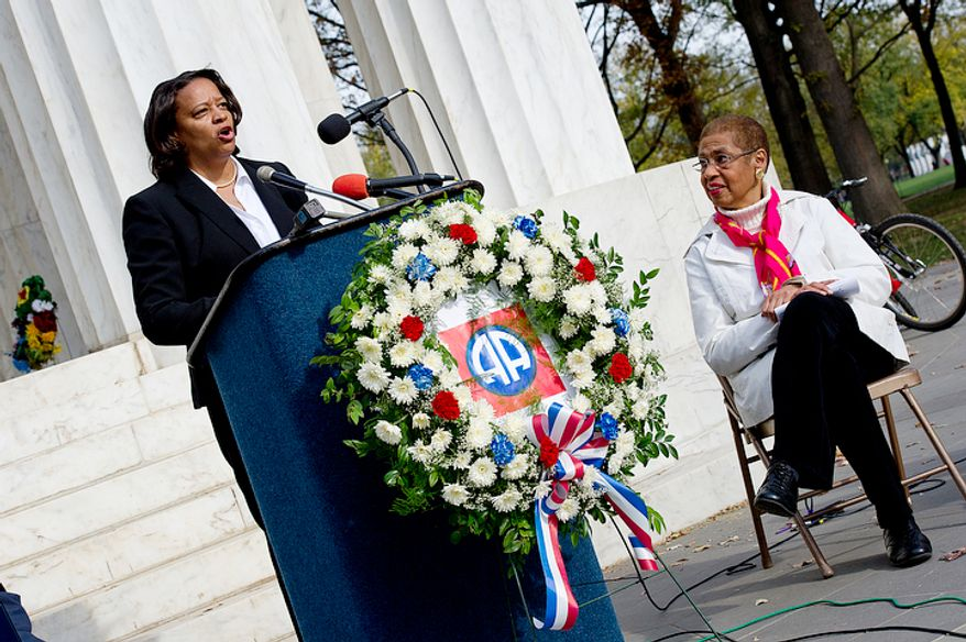 Congresswoman Eleanor Holmes-Norton, right, listens as Tomi Rucker, a Washington, D.C. Navy mom, talks about how she and her husband were saddened by the fact that the D.C. flag was not a part of her son's Navy boot camp graduation, when flags from the other states with graduates were present. Ms. Rucker joined the D.C. officials at the D.C. World War I Memorial on Monday, Nov. 12, 2012 to talk about the inconsistent flying of the D.C. flag at military graduations. Holmes-Norton is calling upon to president to require that the D.C. flag be flown at military functions where the flags of all 50 states are flown. (Barbara L. Salisbury/The Washington Times)