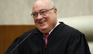 **FILE** Chief Judge Royce Lamberth of the U.S. District Court in Washington is pictured May 1, 2008, during a ceremony where the title of chief judge for the U.S. District Court in Washington was passed from Judge Thomas F. Hogan to Lamberth at the federal courthouse in Washington. (Associated Press)