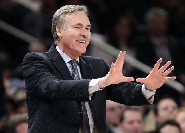 FILE - In this Feb. 22, 2012, file photo, then-New York Knicks coach Mike D'Antoni gestures in the second half of an NBA basketball game against the Atlanta Hawks in  New York. D'Antoni's agent says the Los Angeles Lakers have signed the former coach of the Suns and Knicks to a four-year contract to replace Mike Brown in a deal late Sunday, Nov. 11, 2012, two days after the Lakers fired Brown five games into the season. (AP Photo/Kathy Willens, File)