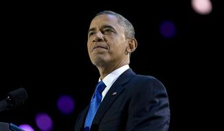 ** FILE ** In a Wednesday, Nov. 7, 2012 photo, President Obama pauses as he speaks at the election night party at McCormick Place, in Chicago. (AP Photo/Carolyn Kaster, File)