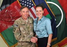 """U.S. Army Gen. David H. Petraeus, then-commander of the International Security Assistance Force and U.S. Forces-Afghanistan, shakes hands with Paula Broadwell, co-author of  """"All In: The Education of General David Petraeus,"""" in a July 13, 2011, photo from the ISAF's Flickr website. (Associated Press/International Security Assistance Force) ** FILE **"""