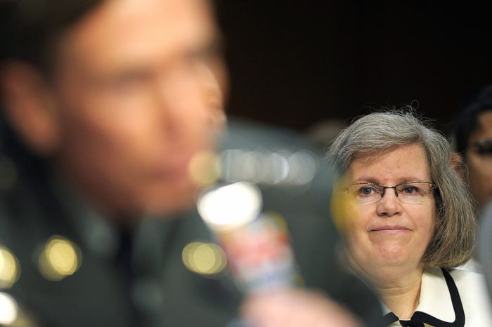 **FILE** Holly Petraeus looks on as her husband, then-CIA Director nominee Gen. David Petraeus, testifies June 23, 2011, before the Senate Intelligence Committee on Capitol Hill in Washington. (Associated Press)