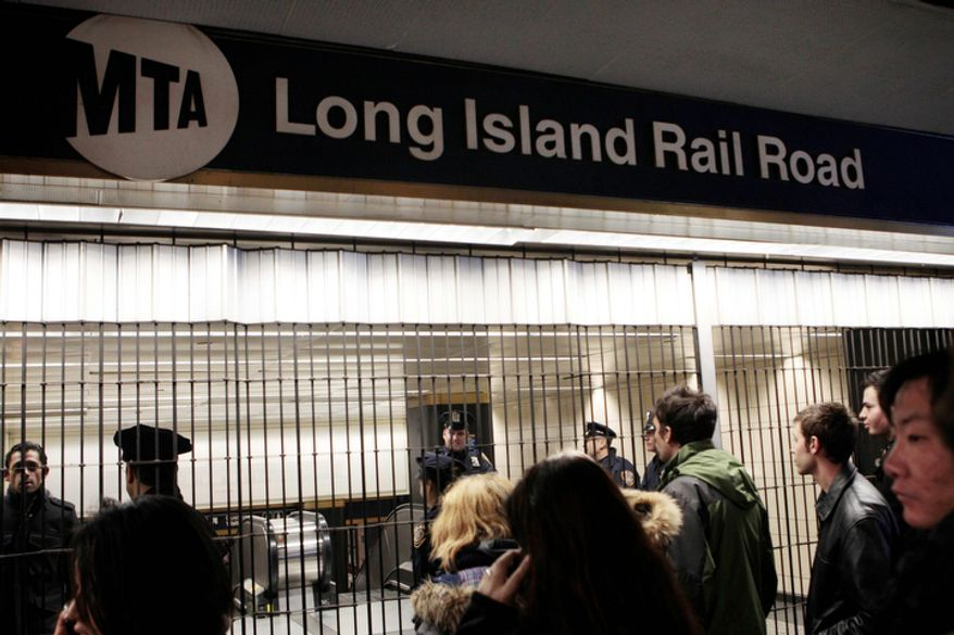 **FILE** Patrons are directed away from the Long Island Railroad as service is suspended on Nov. 7, 2012, due to an approaching nor'easter sweeping the same regions hit by Superstorm Sandy more than a week ago. (Associated Press)