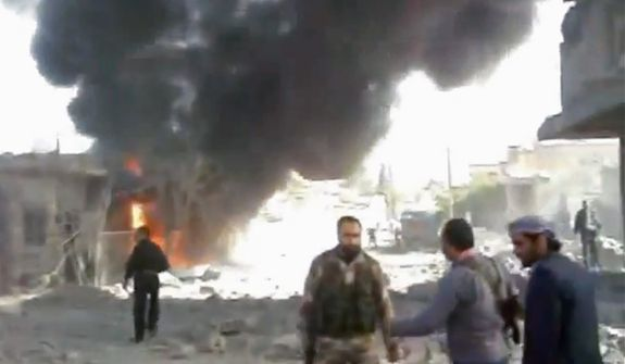 This image taken from video obtained from Shaam News Network, which has been authenticated based on its contents and an Associated Press journalist who saw a plane bomb an area around the Syrian-Turkish border town of Ras al-Ayn, shows Syrians inspecting the damage and looking for victims moments after an airstrike by Syrian warplanes in Ras al-Ayn, Syria, on Nov. 12, 2012. (Associated Press/Shaam News Network via AP video)
