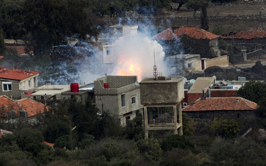 "An explosion after shells fired by the Syrian army hit the Syrian village of Bariqa on Nov. 12, 2012. The Israeli military says ""Syrian mobile artillery"" was hit after responding to stray mortar fire from its northern neighbor. The incident marked the second straight day that Israel has responded to fire from Syria that does not appear to be aimed at Israeli targets, nonetheless Israel has promised a tough response if the fire continues. (Associated Press)"
