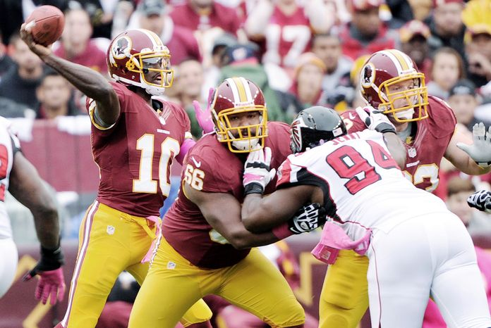 Redskins guard Chris Chester (66) and center Will Montgomery have provided protection for QB Robert Griffin III and opened up holes for the ground game. (Preston Keres/Special to The Washington Times)