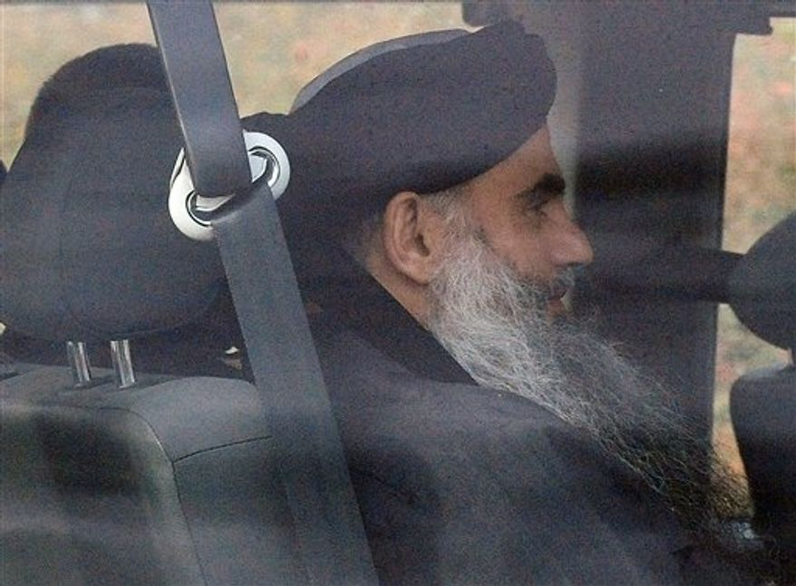 Islamic cleric Abu Qatada is driven out of Long Lartin high security prison in Worcestershire, England, after winning the latest round in his battle against deportation, Tuesday Nov. 13, 2012. British authorities say radical Islamist cleric Abu Qatada has been freed from prison after a court ruled he cannot be deported from Britain to Jordan to face terrorism charges. (AP Photo/ Rui Vieira/PA)