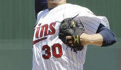Minnesota Twins Scott Baker in a spring training baseball game in Fort Myers, Fla., Monday, March 26, 2012. (AP Photo/Charles Krupa)