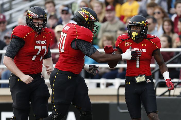 Maryland wide receiver Stefon Diggs (1) celebrates his touchdown with teammates Mike Madaras (77) and De'Onte Arnett (70)in the fourth quarter of an NCAA college football game against Boston College in Boston, Saturday, Oct. 27, 2012. Boston College won 20-17. (AP Photo/Michael Dwyer)