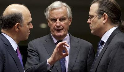 Michel Barnier (center), European Commissioner for Internal Market, speaks with French Finance Minister Pierre Moscovici (left) and Swedish Finance Minister Anders Borg during a meeting of EU finance ministers at the EU Council building in Brussels on Nov. 13, 2012. (Associated Press)